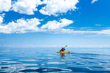 A man in a sea kayak on Lake Baikal