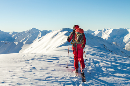 Male ski tourer enjoying the view on a summit in the alps Banque d'images