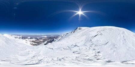 Spherical panorama of the Pamir mountain. Slope of Lenin Peak to an altitude of 6800 meters. Spherical panorama 360 degrees 180 Mountain hiker to climb a mountain of snow couloir.