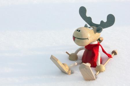 christmas reindeer: Christmas deer skier in snow, clouse up Stock Photo