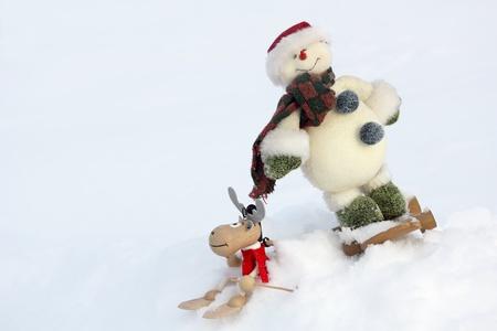 Christmas symbols: deer and snowman, close up photo