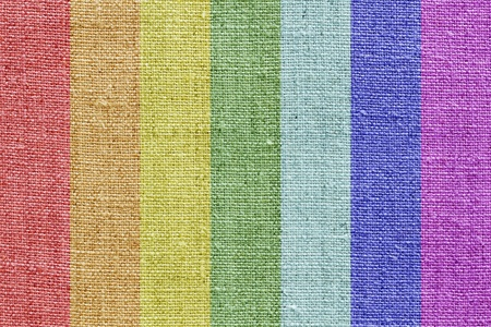 natural linen texture in the rainbow colors for the background Stock Photo