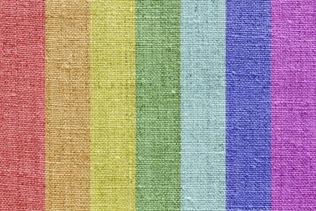 tela algodon: textura de lino natural con los colores del arco iris para el fondo