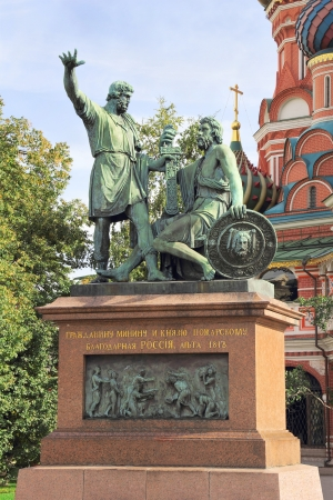 Monument to Minin and Pozharsky on the Red Square in Moscow Russia. Saint Basil's Cathedral on the background