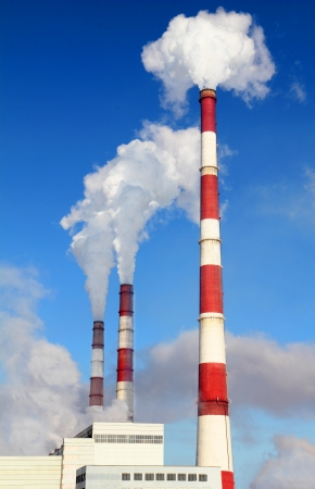 contamination: Smoking pipes of thermal power plant against blue sky