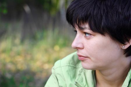 contemplative: portrait of a beautiful pensive woman close up Stock Photo