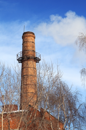 Smoking pipes of thermal power plant against blue sky photo