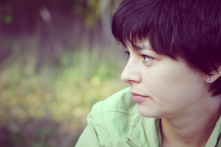 pathetic: portrait of a beautiful pensive woman close up  Stock Photo