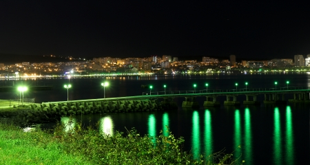 night view of the sea town photo