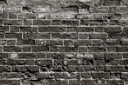 black stones: Old brick wall with dark bricks Stock Photo
