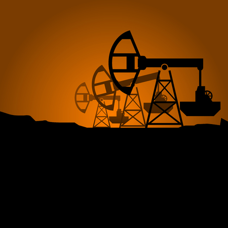 Silhouettes of petroleum pumpjack on sunset - oil pumps