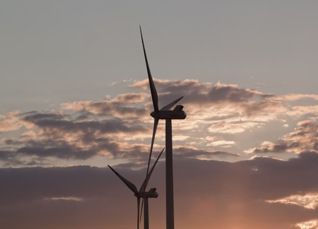 Wind turbines over the sunset Stock Photo