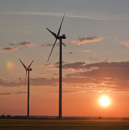 Wind turbines over the sunset