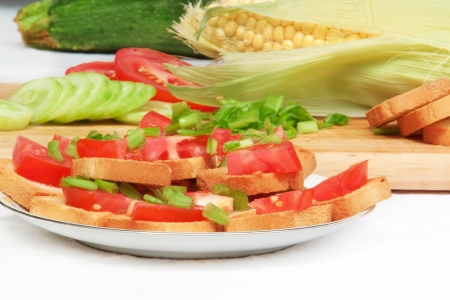 Plate with sandwiches with toamtoes, cucumber Stock Photo
