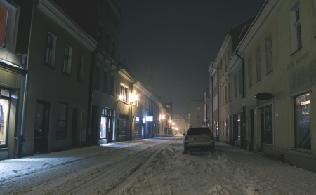 Old town by snowy night  photo