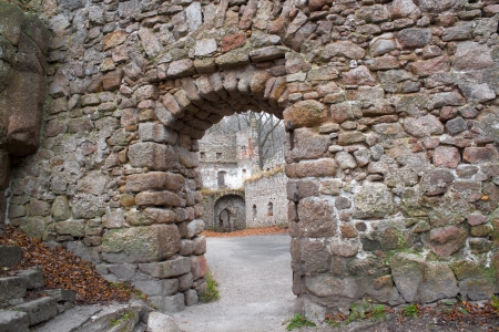 Medieval castle Bolczow ruins in forest, Poland