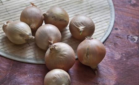 onions on a wooden board  Stock Photo