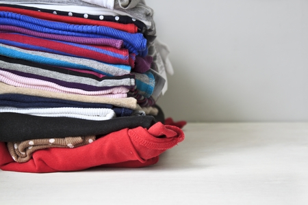 Pile of colorful clothes, stack of clothing