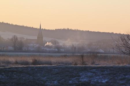 restful: small village church at sunrise