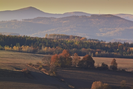 sudetes: Hills and forest at autumn sunrise Stock Photo