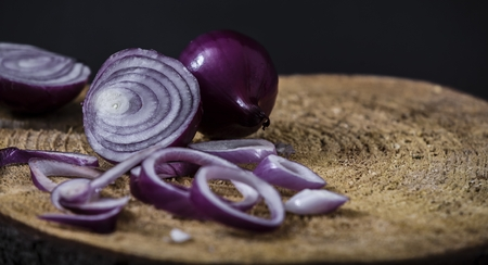 Red onion on wooden rustic backround Stock Photo