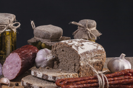 still-life with dark bread and  snack stick sausage  Stock Photo