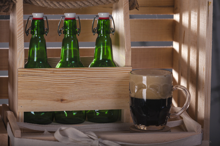 Crafting beer in bottles and glasses