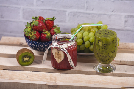 Smoothies and fresh fruits on the table
