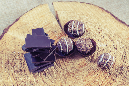 Chocolate sweets on a brown background 免版税图像