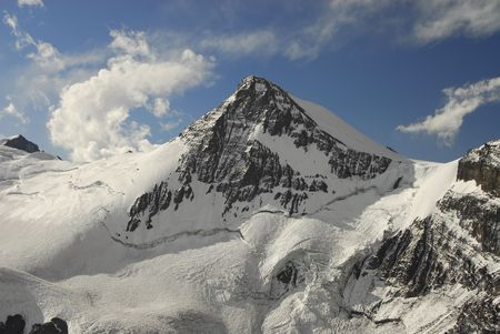 top seven: Massive sunlit peak  Stock Photo