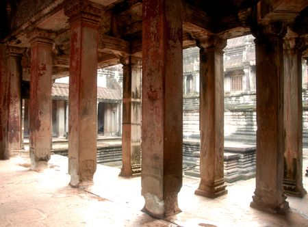 angor: An Ancient Room Of Columns Lit by The Early Morning Light of Angor wat, Cambodia. Stock Photo