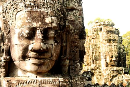 An ancient series of Hindu and Buhddist god-like faces in the bayon temple. Siem reap, Cambodia