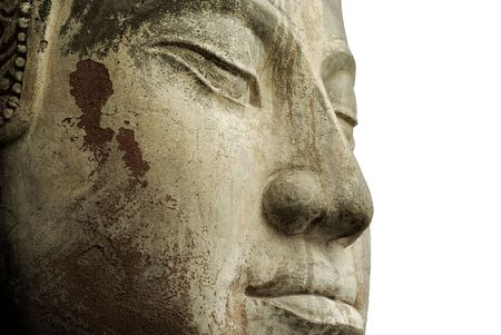 cambodia sculpture: The face of an ancient Buddha statue against white.