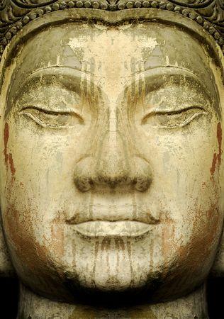 social history: Close up ofan ancient stone Buddha.