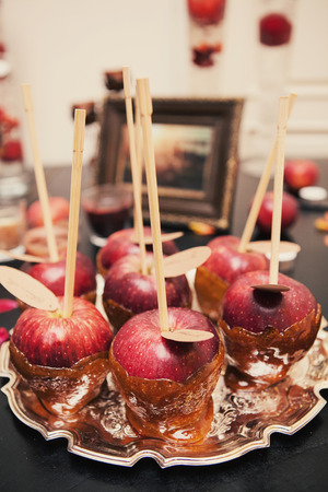 candy apple: Appetizer of Candy apple red on wooden table