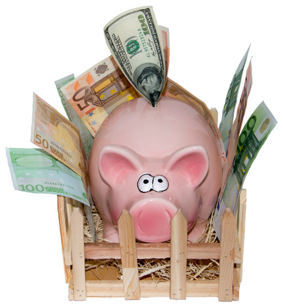 deposit slip: Full piggy bank on a white The money has to be beside the bank since it is full of banknotes and coins