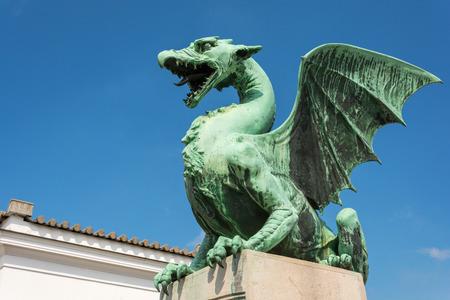 blue dragon: Green dragon on the dragon bridge in Ljubljana on a sunny day Stock Photo