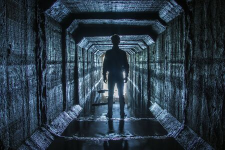Man stands at the entrance to the underground rive 스톡 콘텐츠 - 133424669
