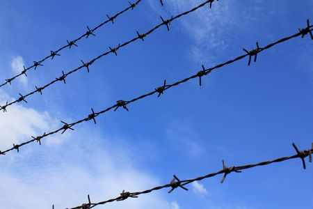 frence: barbed wire and blue sky Stock Photo