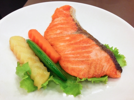 Salmon steak put on a white plate photo