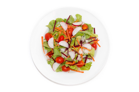 The fresh vegetable salad isolated on white background photo