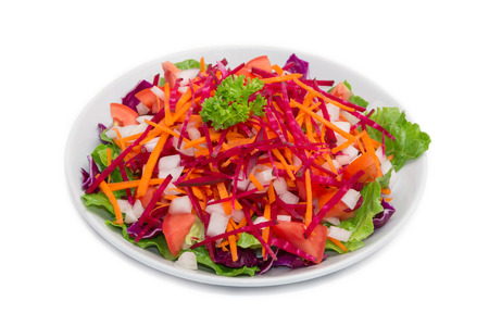 The colorful fresh vegetable salad isolated on white background