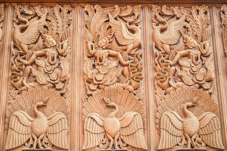 Old wooden carving in Thai style Stock Photo