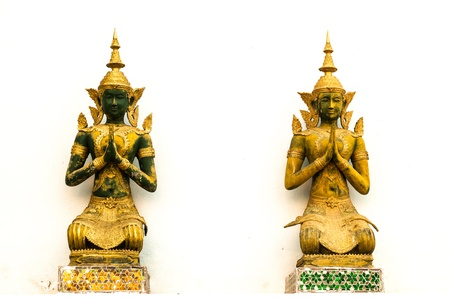 Thai angel statues in the temple  On a white background  Stock Photo