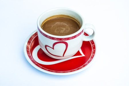 close up of a coffee cup on white background