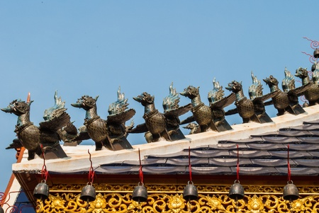The birds statues on the roof of the Thai church  Stock Photo