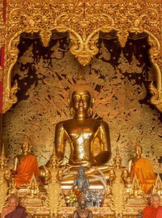 golden buddha statue image in Thai Temple, Thailand Stock Photo