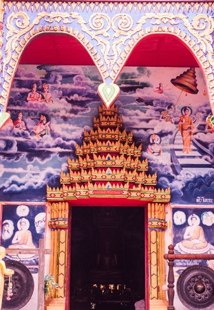 The golden door of the Thai temple architecture is marvelous painted and decorated  Stock Photo