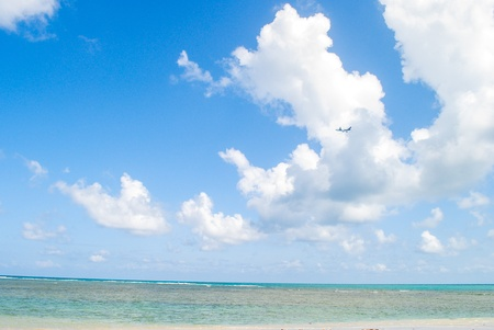 Airplane flying over the sea with fancy cloud