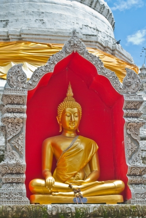 Golden Buddha Statue in red frame